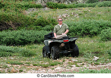 ATV Rider - Handsome young man resting during ATV ride...