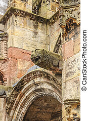 Gargoyle at Rosslyn chapel - Gargoyle at wall of medieval...