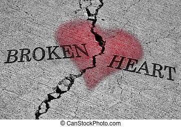 Broken Heart - Large crack in cement with words broken heart...