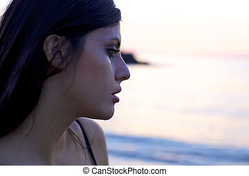 Sad woman crying during sunset - Beautiful woman left alone...