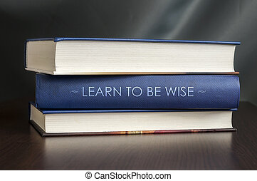 Learn to be wise. Book concept. - Books on a table and one...