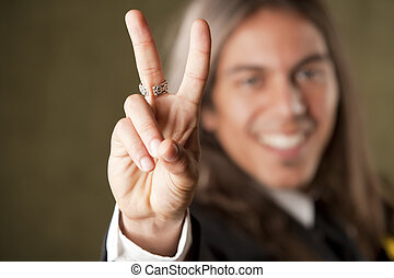 Handsome man in formalwear making a peace sign - Handsome...