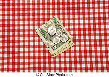 Tip on Table - Tip left on restaurant table. Bills and coins...