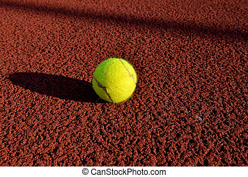 Tennis ball in a court. Useful for tennis background designs.