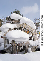 Waterwheel with heavy snow