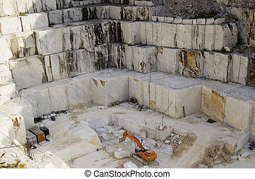 quarry of marble - An open quarry of white marble in...