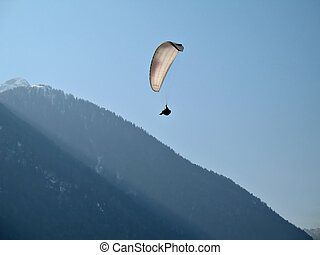 White Paraglide - A paraglider il flying in the blue sky...
