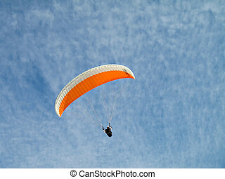 Orange Paraglide 2 - A paraglider il flying in the sky with...