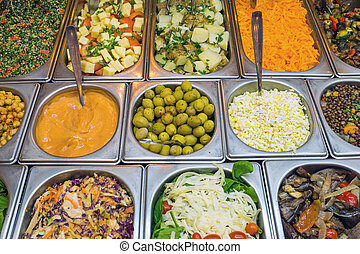 Salad bar with a lot of choice - A salad bar with a lot of...