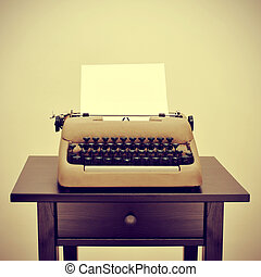old typewriter - an old typewriter with a blank page on a...