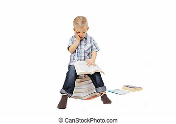 Little boy sitting on stack of book