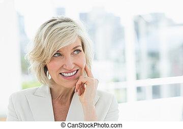 Mature businesswoman looking away - Close-up of a mature...