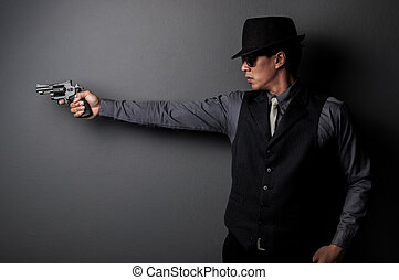killer and mafia man hold gun