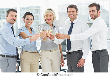 Business team toasting with champag - Group of happy...