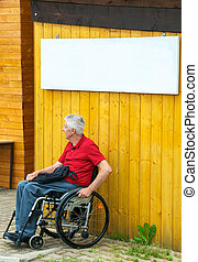 Waiting in a Wheelchair with Copyspace - Retired person in a...