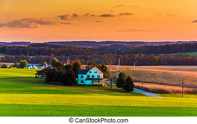 View of rolling hills and farm fields at sunset in rural York County, Pennsylvania.