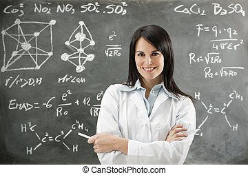 science - portrait of mid adult teacher looking at camera