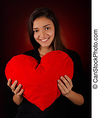 Girl Holding a Big Plush Heart - Beautiful girl holding a...