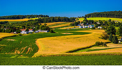 View of rolling hills and farm fields in rural York County,...