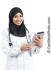 Arab doctor woman with a tablet looking at camera isolated...