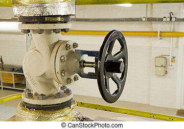 Steam pipe with a valve in the boiler room