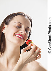 young woman with a strawberry