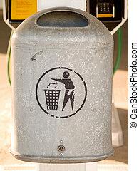Grey metal rubbish bin with copyspace in urban area