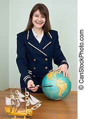 Woman in a sea uniform with the globe