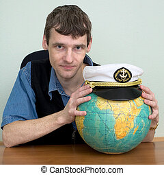 Man with the globe and a cap