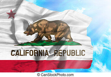 California waving flag against blue sky with sunrays