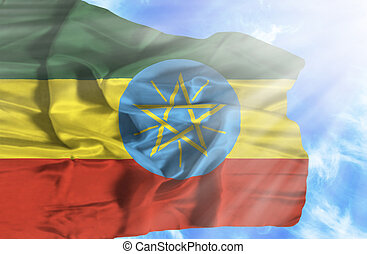 Ethiopia waving flag against blue sky with sunrays