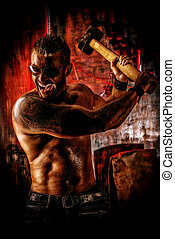 destroyer - Handsome muscular man with sledgehammer working...