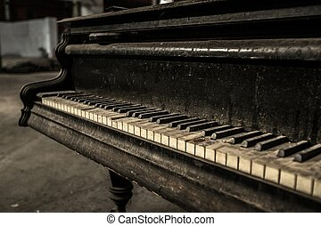 Close up of old dirty piano