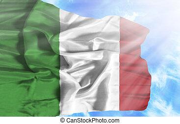 Italy waving flag against blue sky with sunrays