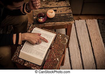 Reading Holy Bible on vintage table - Man reading Holy Bible...