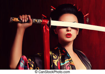 geisha in kimono with samurai sword - Beautiful geisha in...
