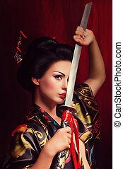 geisha in kimono with samurai sword - Beautiful geisha in...