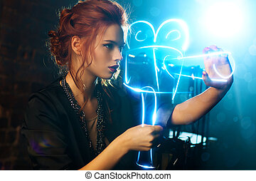 Young woman film director with virtual camera.