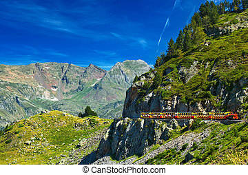 Pyrenees mountains with tourists train.