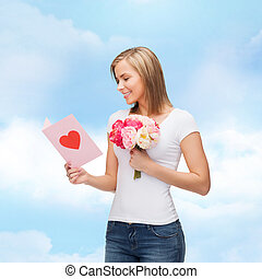 smiling girl with postcard and bouquet of flowers - love,...