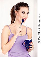 woman holding morning coffee