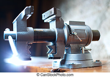 Vise tool on carpenter table.