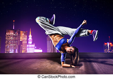 Young woman dancer - Young woman dancing on city background.