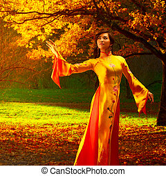 Young vietnamese woman in autumn park.