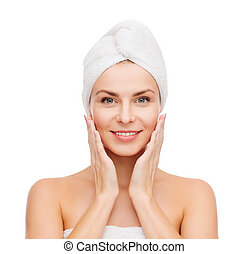 beautiful woman in towel - health, spa and beauty concept -...