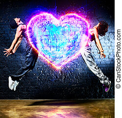 Young couple jumping to heart symbol.