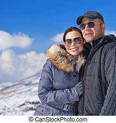 Happy couple in winter mountains