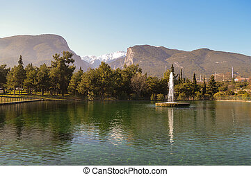 Beautiful lake in Litochoro and Olymp / Olympus mountains in...