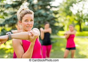 blond girl streching her arms - Cheerful young woman...