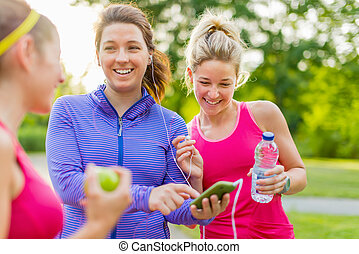 friendship and fitness in the parc - Group of female joggers...